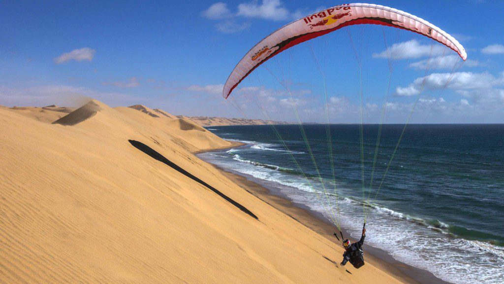 paragliding-over-sand-dunes-in-n-1024x576